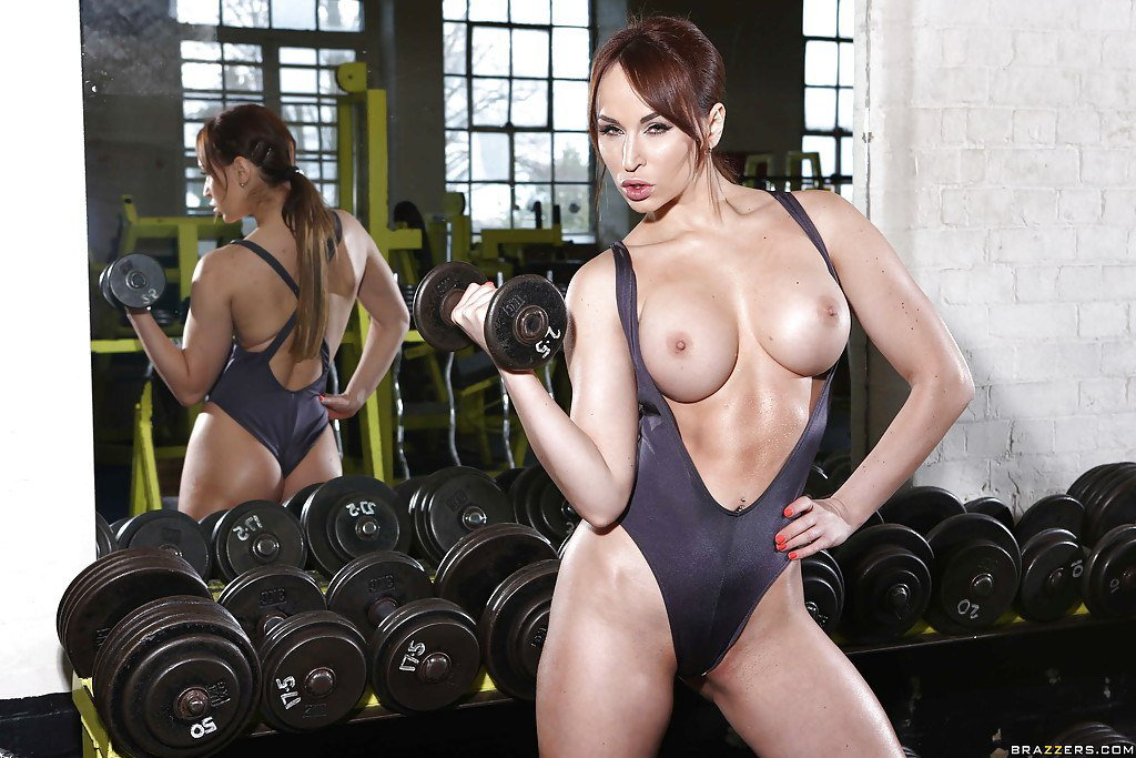 Hot Brunette Model Trinity St Clair Pulls Her Big Tits Out Of Her Sports Bra